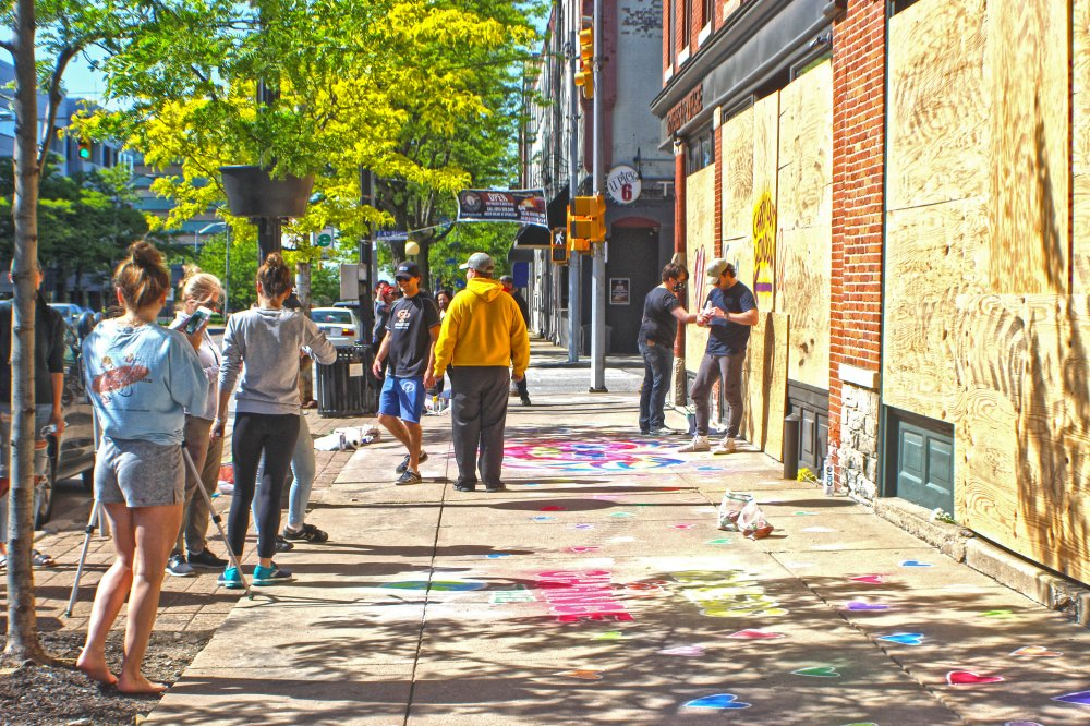 <p>Volunteers help beautify State Street near Ember+Forge. Photo by Nick Warren.</p>