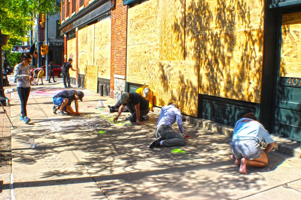 <p>Volunteers helping near Ember+Forge on State Street. Photo by Nick Warren.</p>