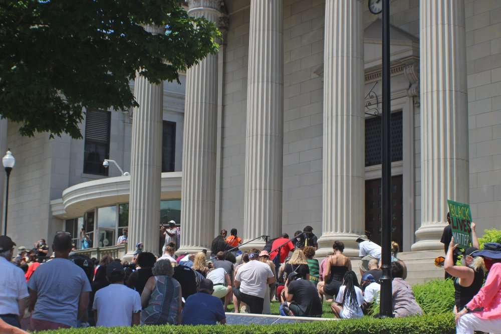 <p>Group kneeling at Erie County Courthouse, Erie, PA June 19, 2020 – Juneteenth Celebration.</p>