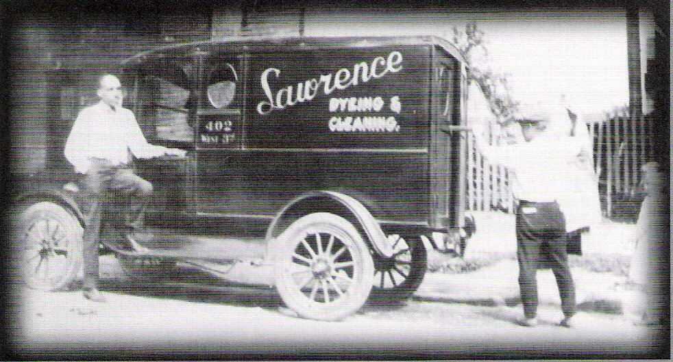 "<p><span style=""color: #3c4043; font-family: Roboto, sans-serif; font-size: 16px; white-space: pre-wrap;"">Charles Lawence (left), Emma's son, who helped run the business. This photo of the company car was likely taken in the 1920s and gives a glimpse of the diverse workforce.</span></p>"