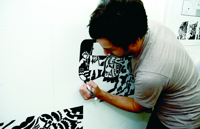 Todd Scalise works on his mural (photo by Joe Cottrell)