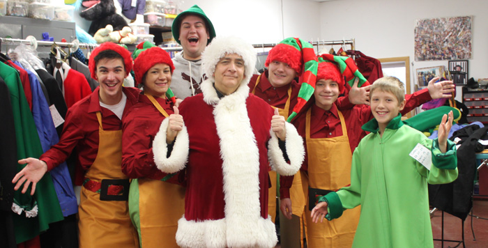 Travel through the one-way street forest, pass the twirly-swirly snowfalls, and walk into the Erie Playhouse for Elf : The Musical